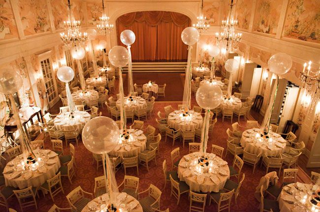 these balloons are a fun way to add a vertical element in a room with high ceilings while adding a playful element to a formal setting