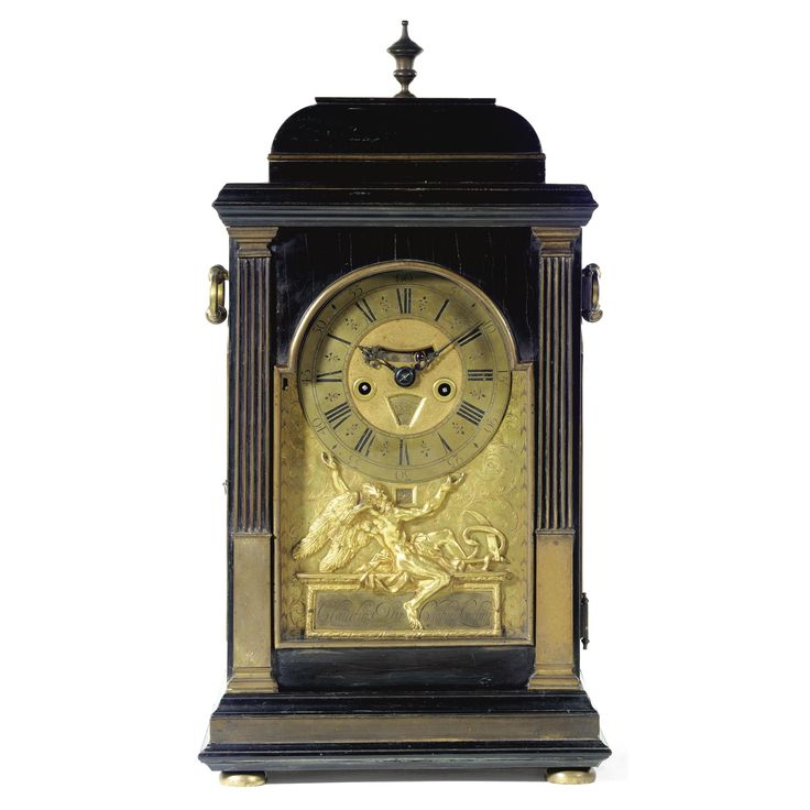 A gilt-brass mounted ebony quarter repeating table clock, Claudius Du Chesne, London 6½-inch dial with matted centre, mock pendulum aperture and day of the week sector with ruling deity, strike/not strike lever at IX, the gilded dial plate engraved with foliate scrolls within a wheat ear border, inset with a calendar aperture and applied with the figure of Chronos apparently supporting the chapter ring seated on a reserve signed Claudius Du Chesne, Londini, the two train fusee movement with…