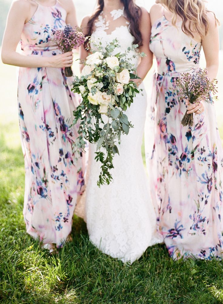 bridesmaids in floral dresses - http://ruffledblog.com/lavender-inspired-wedding-at-springfield-manor