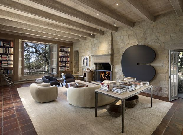 In Ellen DeGeneres's living room comes complete with a library, fireplace and 18th century Italian floor tiles.