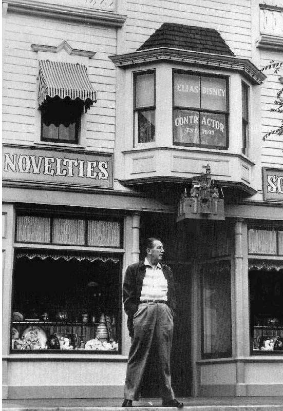 Walt Disney below the Disneyland window dedicated to his father.