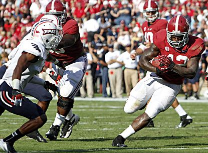 Alabama running back Eddie Lacy runs for a first down against Florida Atlantic. Lacy rushes for 106 yards in the first half. (AP)