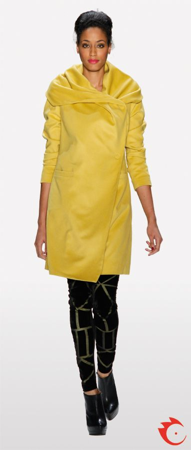 anja gockel yellow stylish long jacket in combination with black fake leather golden striped pants