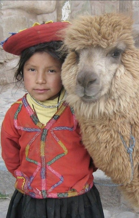 Peruvian girl posing with her alpaca near the Plaza de Armas in Cusco, Peru