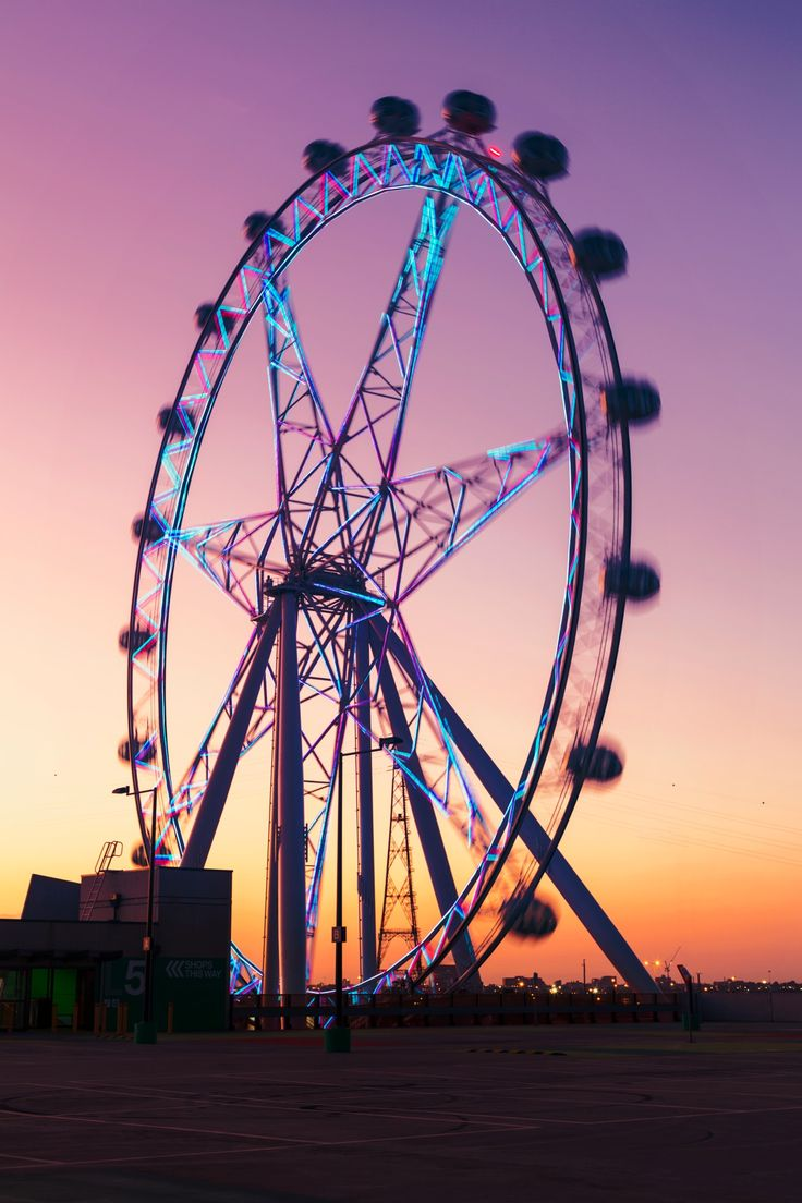 Sunset Behind the Ferris Wheel - Beautiful gradient sunset of purple, pink and yellow behind the ferries wheel or Melbourne Star observation wheel.