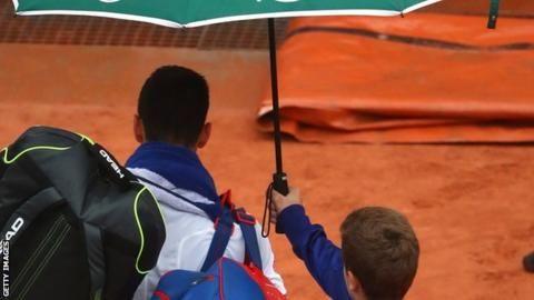 French Open: Novak Djokovic losing to Roberto Bautista Agut when rain halts play