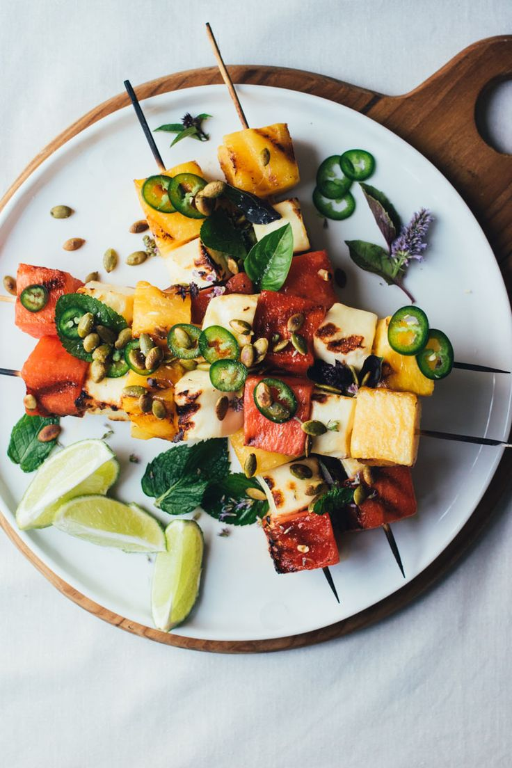 Grilled Watermelon and Halloumi skewers, topped with fresh herbs, toasted pumpkin seeds, lime, and jalapeños! Perfect summer grill food! #EatMoreWatermelon