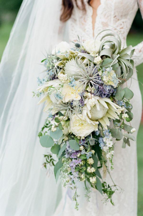 Soft lavender gray, cream and blue wedding bouquet: http://www.stylemepretty.com/little-black-book-blog/2016/08/19/elegant-romantic-chicago-ballroom-wedding/ Photography: Tamara Gruner - http://www.tamaragruner.com/