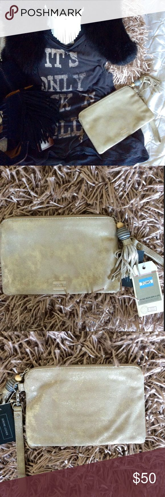"TOMS Party Metallic Pouch Boho chic TOMS pouch wristlet.  Super cute and fun.  New with tags.  Made of leather.  9.5"" x 6"". For you or a gift comes with bag TOMS Bags Clutches & Wristlets"