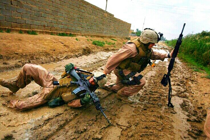 This is what a HERO looks like! KARMAH, Iraq—Sgt. Jesse E. Leach drags Lance Cpl. Juan Valdez, of Weapons Company - 2nd Battalion - 8th Marines, to safety just moments after he was shot by a sniper during a patrol. Valdez was shot through the arm and right torso but survived, Oct. 31, 2006.