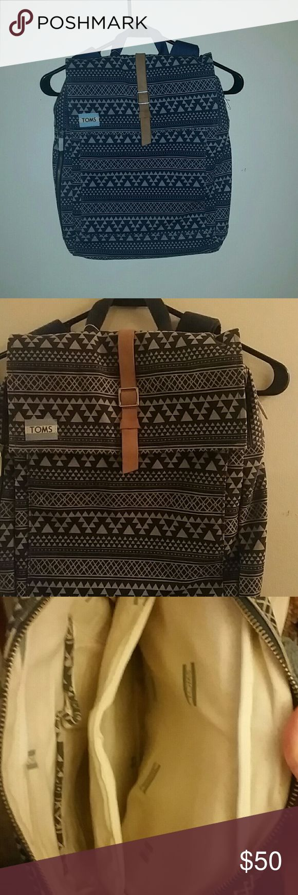 TOMS Backpack Start the new year off right with a brand new backpack, never been used! This backpack has a front pocket, magnetic clasp, 2 pockets inside with a pencil holder. TOMS Bags Backpacks