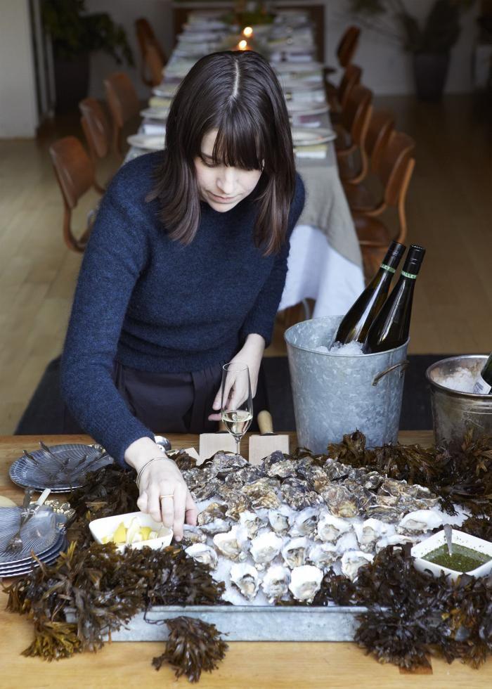 Argh, I want everything in this photo, from her hair to the wooden chairs, not to mention the pile of oysters.  parisian oyster party | remodelista