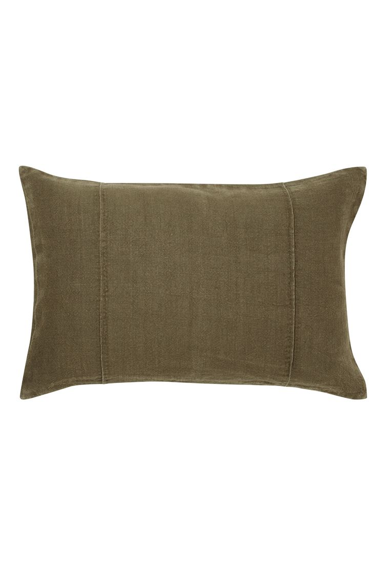 Washed linen cushion cover featuring a pintuck panel adds relaxed style to a…
