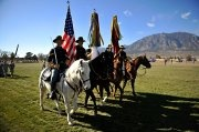 U.S. Army Soldiers from the 4th Infantry Division mounted Color Guard horse ride during the pass and review portion of the division's change of command ceremony at Ft. Carson, CO. Nov. 16, 2011.