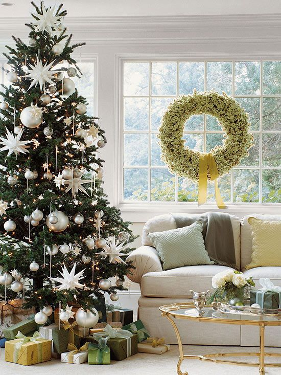 Tip #1: Think Overscale  Our first tree illustrates a technique that most home decorators miss: using overscaled ornaments. The large silver balls and stars have a huge impact. Though oversized decorations may cost a bit more, you won't need many (about a dozen for an average size tree), and the effect will be stunning.: