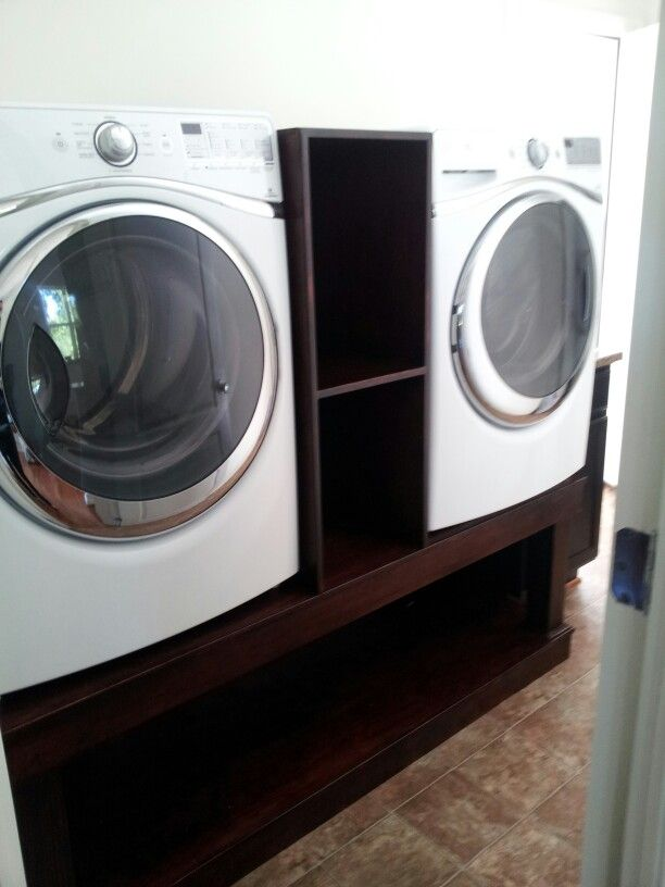 Laundry pedestal with laundry baskets underneath