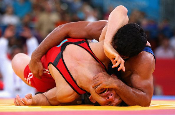 Sushil Kumar of India in action against Akzhurek Tanatarov of Kazakhstan during the Men's Freestyle Wrestling 66kg semi final match on Day 16 of the London 2012 Olympic Games  at ExCeL on August 12, 2012 in London, England.