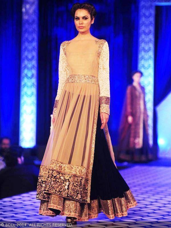 Miss Asia Pacific World '13 Srishti Rana showcases a creation by designer Manish Malhotra during 59th Idea Filmfare Nomination party, held at Hyatt Regency, in Mumbai, on January 15, 2014.