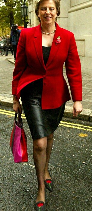 Teaming leather with roses (left), Mrs May's footwear choices have earned her plenty of he...
