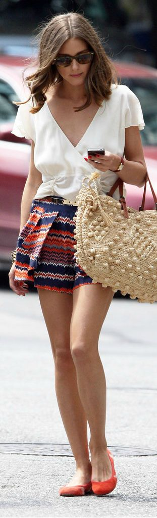 Olivia Palermo in a cream top and warm, bright shorts - love for the transition into fall in the south!