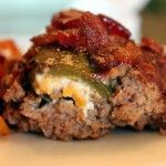 This amazing smoked meatloaf recipe has cream-cheese stuffed jalapeños stuffed inside and is topped with my barbecue sauce and bacon crumbles.