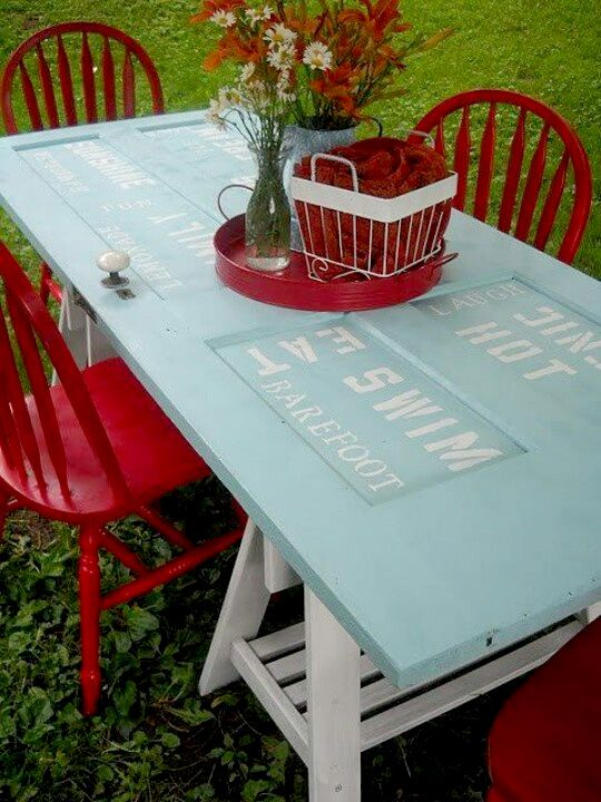 Creative Picnic Table - Upcycled door and old saw horses!