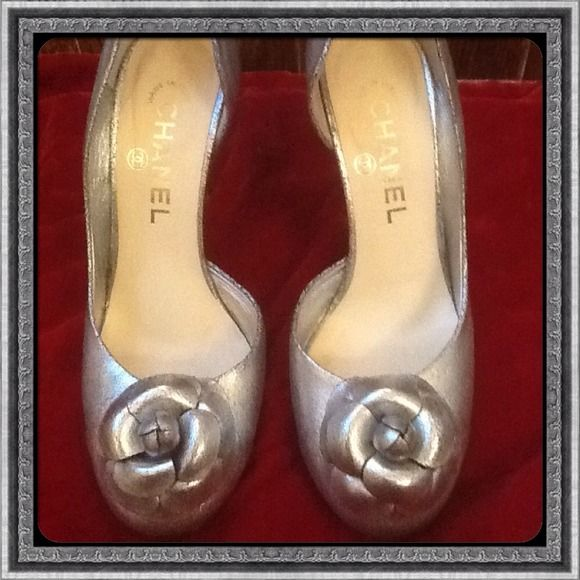 Additional pictures of CHANEL shoes These shoes are a crackled metallic silver; they are in excellent condition; the left  back of the heel has some slight surface scratch; but not noticeable due to the intentional distressed leather look of the shoes; price firm; purchased at Neiman Marcus in Fort Lauderdale, FL; I am ambivalent about giving them up because they are so beautiful CHANEL Shoes