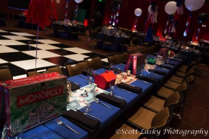 This long Monopoly themed table was where all the kids sat at this game night themed Bar Mitzvah! Read more about this party at MitzvahMarket.com.