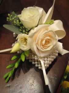 ivory rose and white freesia corsage