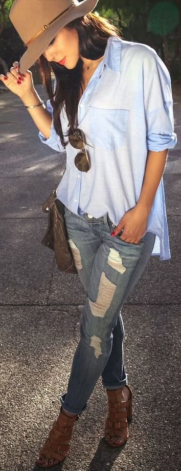 Oversized button up + distressed denim.