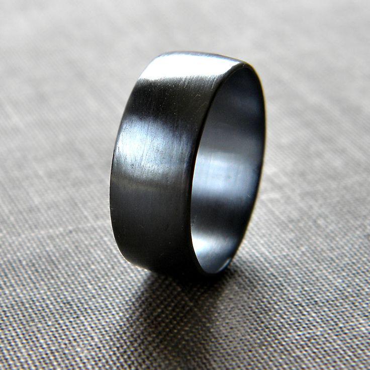 Brushed men's oxidised silver ring.