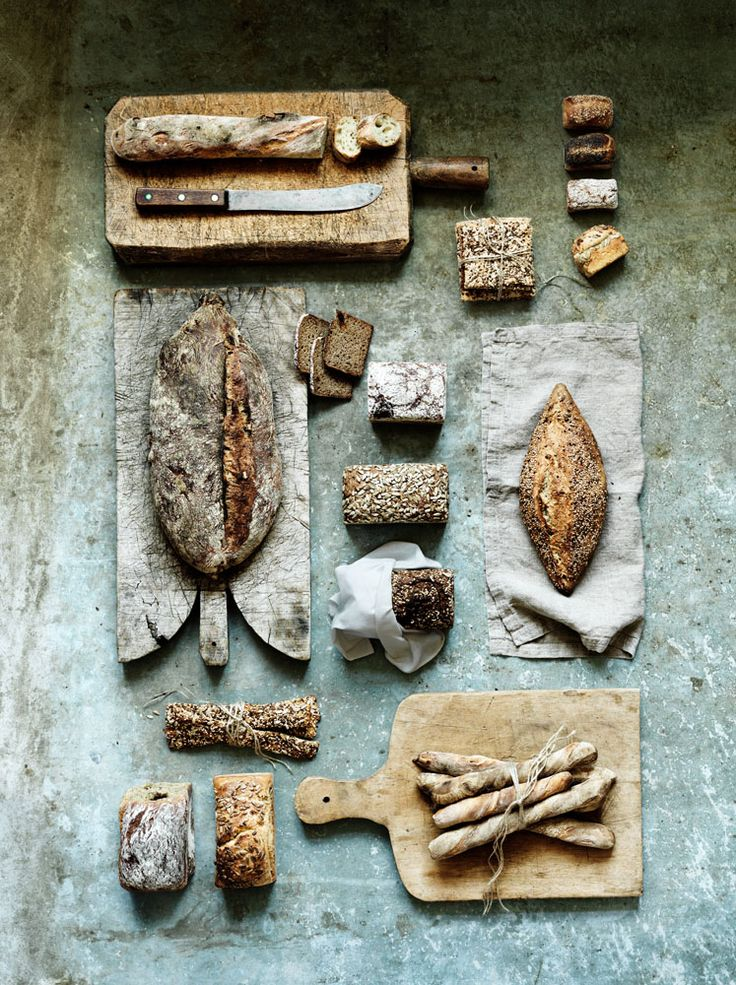 Linda Lundgren, love everything about this, background, lighting, & textures of the breads and textiles.