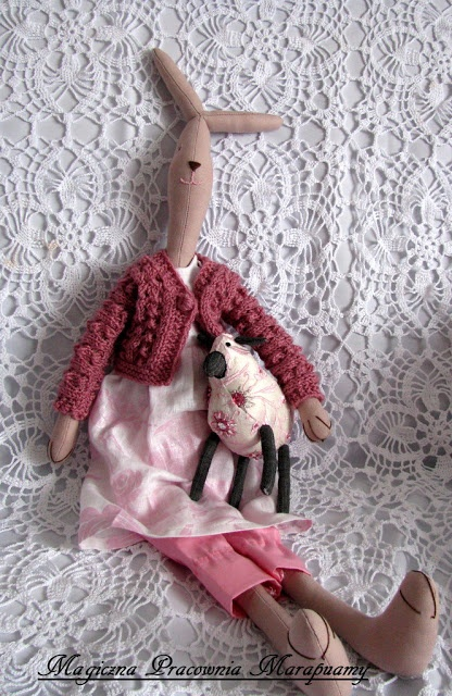 Romantic, pink-gray lamb, accompanied by a pink rabbit.