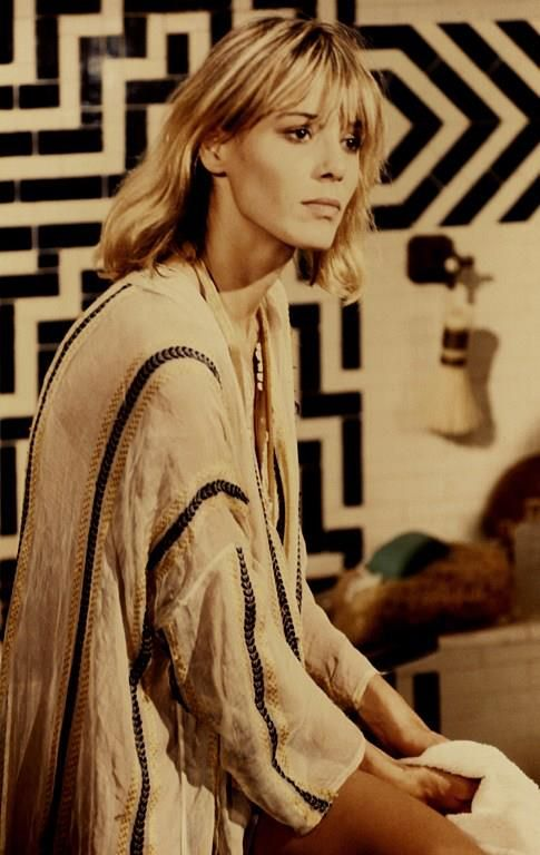 Anita Pallenberg (photo late 60's) shows us how to do bangs right. Cut showcases bangs trimmed extra long, below the brow, and natural waves.