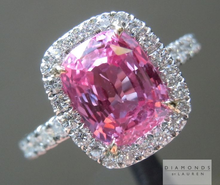 this bubble gum pink sapphire looks amazing in this diamond halo ring