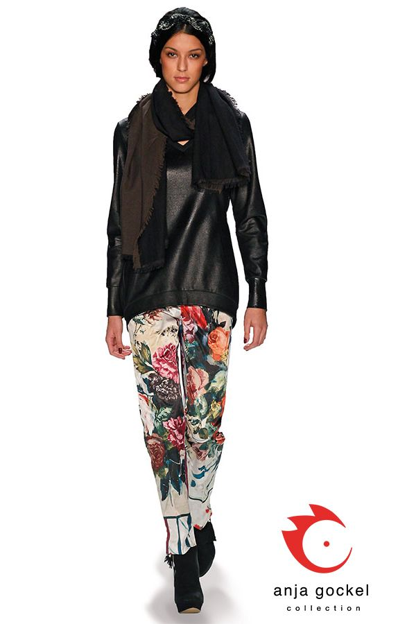 Leather optic top contrasted to diva trousers in cotton rose print.