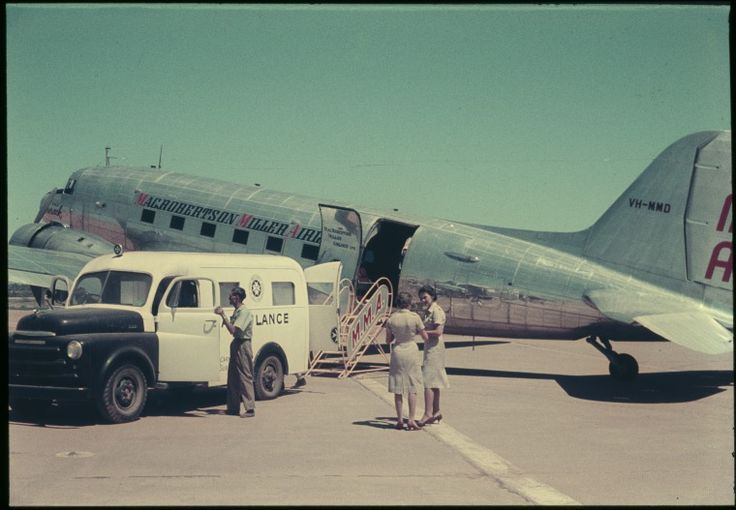 145314PD: A patient is transferred from an ambulance to MMA's VH-MMD 'RMA Durack' at Carnarvon Airport, ca.1960. http://encore.slwa.wa.gov.au/iii/encore/record/C__Rb4768921__S145314pd__Orightresult__U__X3?lang=eng&suite=def