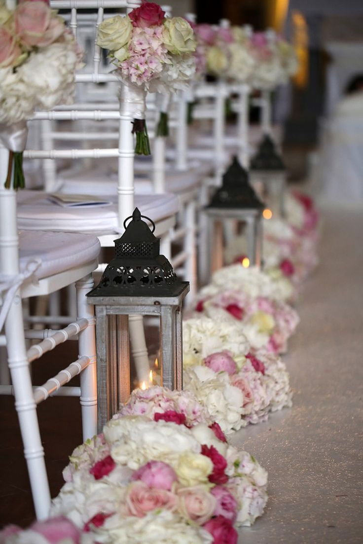 Pastel flowers decoration for path to the altar with lanterns