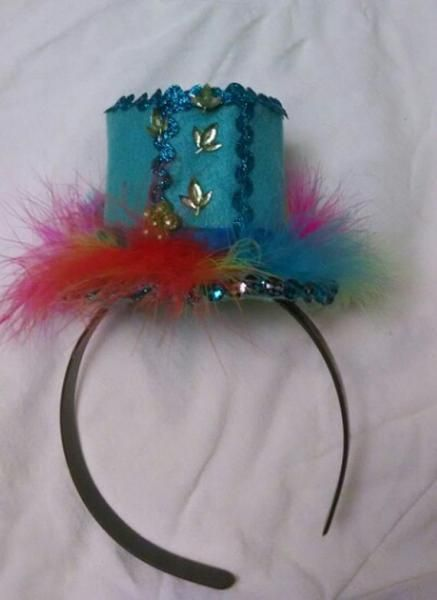 Handmade rainbow feather and blue mini hat by Kitsart, $20.00 USD