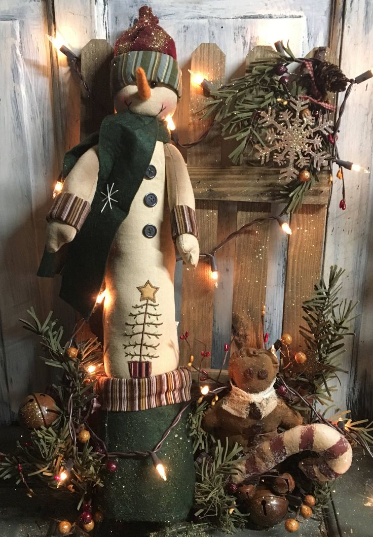 "21"" Primitive Country Christmas snowman against fence with lights by ShelleysPrimitives on Etsy https://www.etsy.com/listing/573682227/21-primitive-country-christmas-snowman"