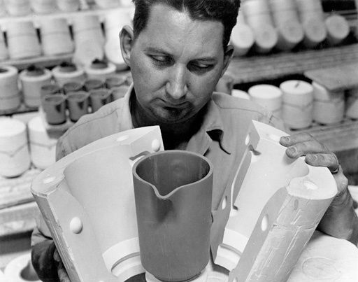 [A man displaying a pottery mold at Crown Lynn Potteries factory] - Collections & Research - Auckland War Memorial Museum