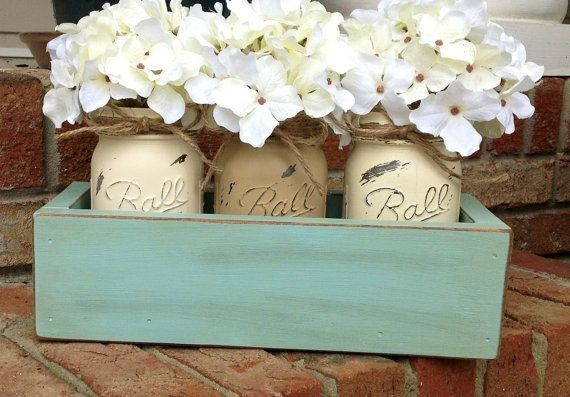 Love this idea the painted mason jars and twine make it shabby chic and the flowers are so country