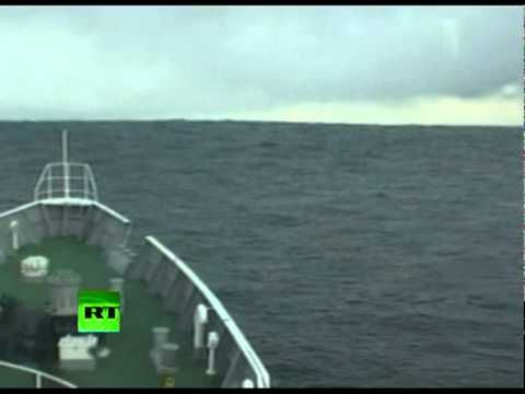 Incredible video of a ship climbing over the Japanese tsunami waves deep out at sea