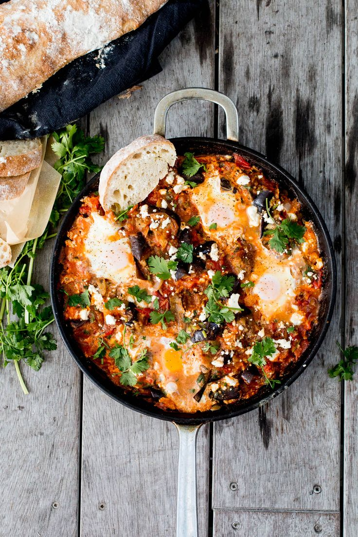 Spiced Roasted Eggplant Shakshuka - paprika, cumin, parsley & coriander roasted eggplant in a warming tomato sauce, baked eggs and crumbled feta.