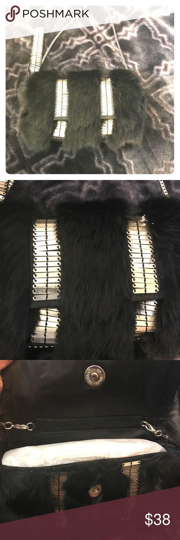 Armani Exchange purse Cute small black furry Armani Exchange purse. Can be worn on the wrist or on the shoulder Armani Exchange Bags Clutches & Wristlets