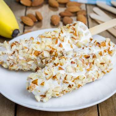 Ingredientes:½ (50g) pote de iogurte grego natural com 0% de gordura 1 pitada de canela 1 banana mad... - Divulgação/Vigilantes do Peso