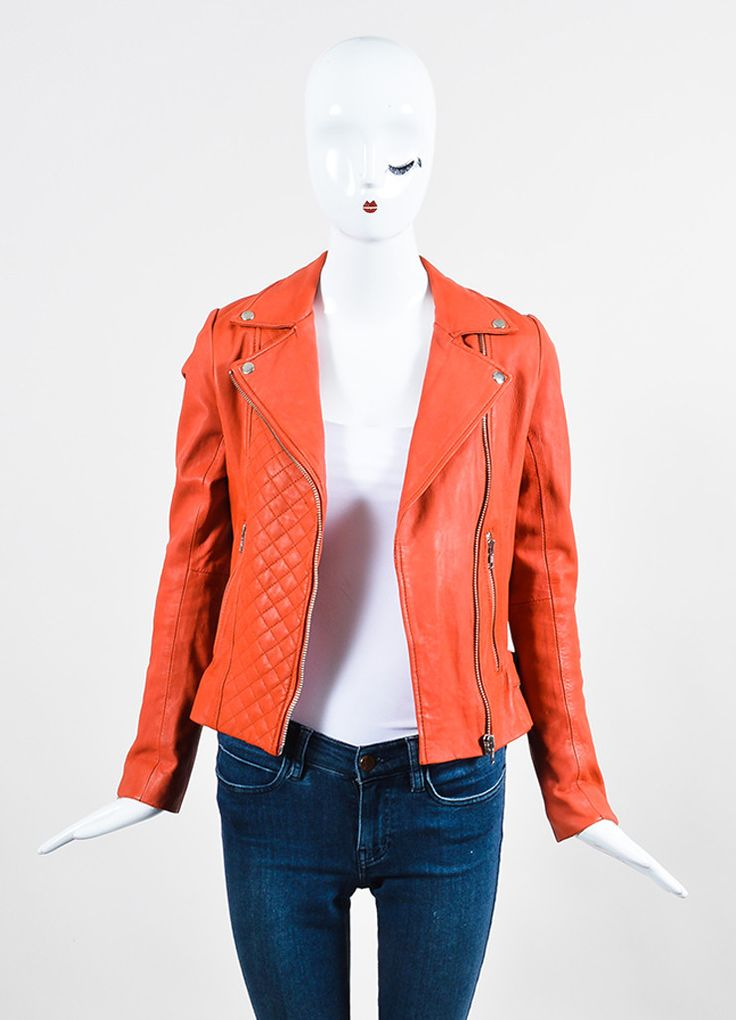 Bright and eye-catching leather jacket by Maje. This juicy orange number features a quilted section at the front and buckles at the lower sides. A more soft and fun alternative to a classic black leat