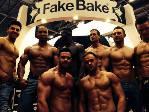The Dreamboys visit the stand and get their Fake Bake tans done - all in a day's work!