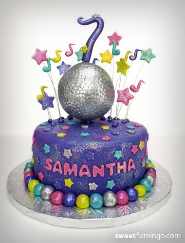 "Dance Party Birthday! - Miss Samantha rocked out her 7th birthday with this awesome ""Dance Party"" inspired cake. The cake?s bright colors, glitter, and sparkling white chocolate disco ball helped make this party a huge hit!  Cake: Triple Chocolate Fudge, Filling: Cheesecake Mousse, & Frosting: Vanilla Bean Buttercream"