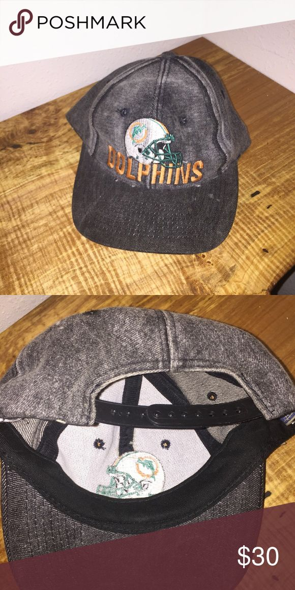 Vintage Football Snapback (Miami Dolphins) Vintage Dolphins Hat. Fits most sizes, unisex. SnapBack. Welcome to offers and trades. Great condition.  #miamidolphins #snapback #hat #footballhat #vintagefootball #jeanhat #cap #womanhat #menhat Accessories Hats